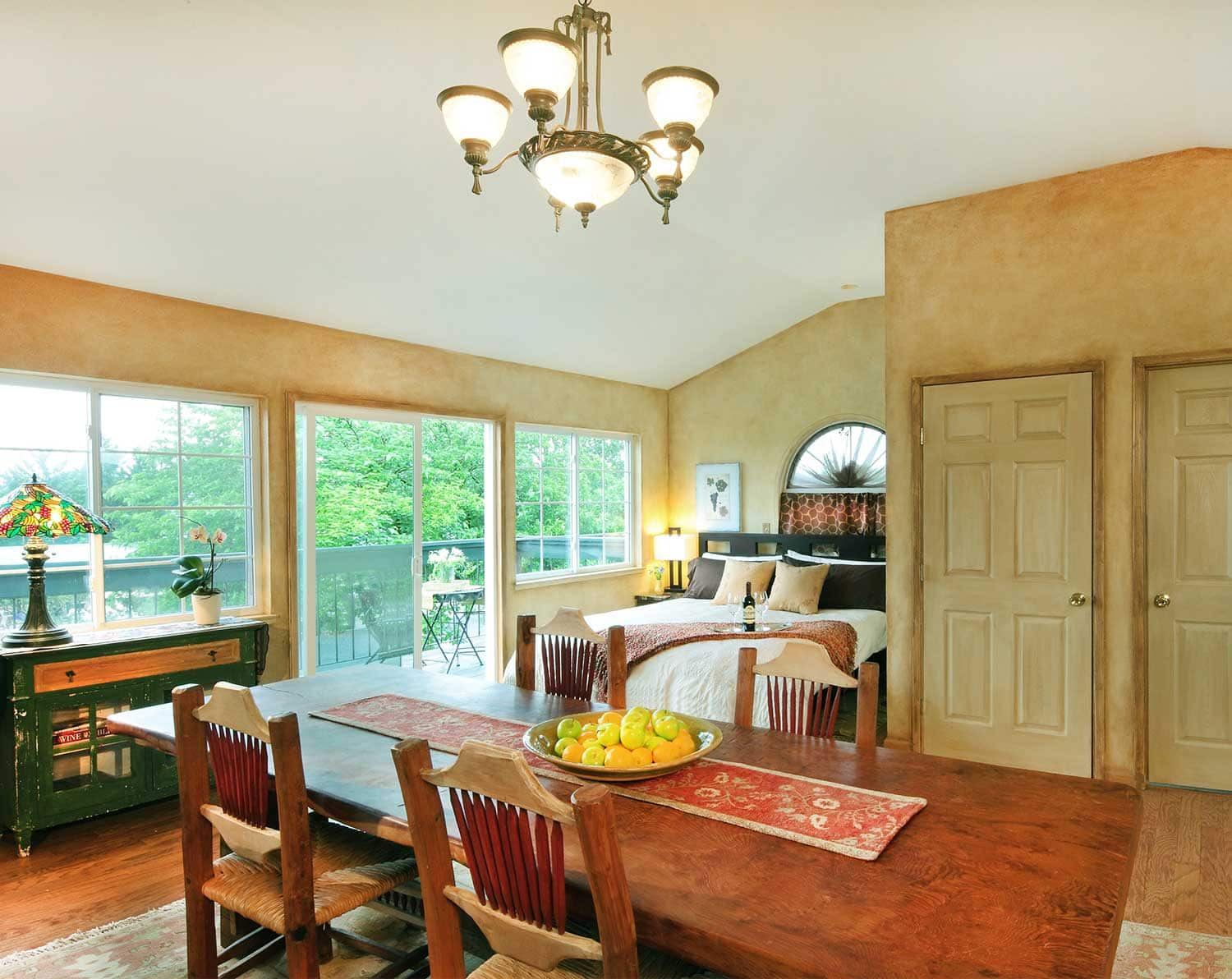 Dining table, luxurious king bed, and incredible vineyard views